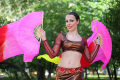 Happy woman dances with veil fans Royalty Free Stock Photography