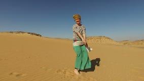 Happy woman dancing barefoot in desert, Egypt stock footage