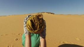 Happy woman dancing barefoot in desert, Egypt stock video footage