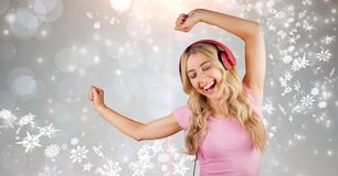 Happy woman dancing while enjoying music on headphones Royalty Free Stock Images
