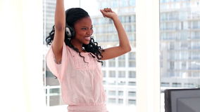 Happy woman dancing in front of the window Stock Image