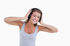Happy woman dancing while listening to music Stock Photography