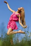 Happy woman dancing in nature Stock Images