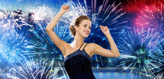 Happy woman dancing over firework in city Stock Photos