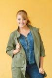 Happy woman in dark green jacket. Autumn fashion. Stock Photography