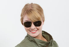 Happy woman in dark green jacket. Autumn fashion. Happy young woman girl in dark green khaki coat posing in studio. Winter autumn fall fashion Royalty Free Stock Images