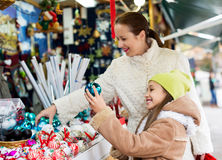 Happy woman with  daughter buying gifts Royalty Free Stock Photography