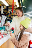 Happy woman with  daughter buying gifts a Royalty Free Stock Photos