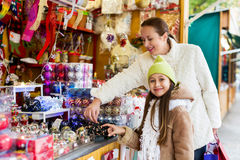 Happy woman with  daughter  at Christmas market Royalty Free Stock Images