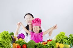 Happy woman and daughter prepare vegetable Royalty Free Stock Image