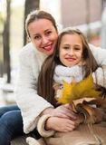 Happy woman with daughter stock image