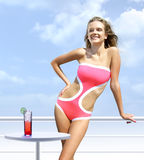Happy woman on a deck takes sunbathing royalty free stock photo