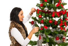 Happy woman decorate Christmas tree Stock Photography