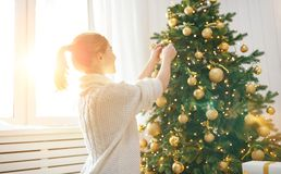 Happy woman decorated  Christmas tree Royalty Free Stock Photo