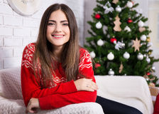 Happy woman in decorated living room with Christmas tree Royalty Free Stock Image