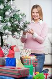 Happy Woman Decorating Christmas Tree Royalty Free Stock Photos