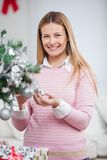 Happy Woman Decorating Christmas Tree Royalty Free Stock Photo