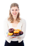 Happy woman with delicious sweet donuts Royalty Free Stock Photography