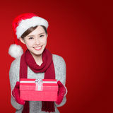 Happy woman delivers christmas gift Stock Images