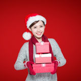 Happy woman delivers christmas gift Stock Image
