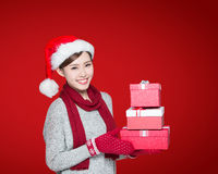 Happy woman delivers christmas gift Royalty Free Stock Photo