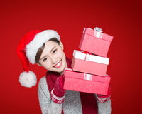 Happy woman delivers christmas gift Stock Photo