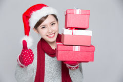 Happy woman delivers christmas gift Royalty Free Stock Image