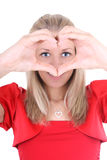 Happy woman depicts  the heart Royalty Free Stock Photos