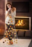 Happy woman with design christmas tree Stock Photos