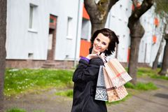 Happy woman with different shopping bags Royalty Free Stock Photos