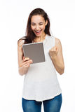 Happy woman and digital tablet Royalty Free Stock Image