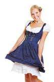 Happy woman in dirndl dancing Stock Photo