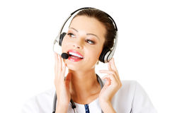 Happy woman doctor wearing headset. Royalty Free Stock Photo
