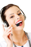 Happy woman doctor wearing headset. Royalty Free Stock Photography