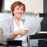 Happy woman with documentation Royalty Free Stock Photos