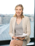 Happy woman with documents. Indoor picture of happy woman with documents Stock Images