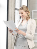 Happy woman with documents Stock Image
