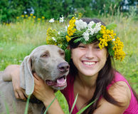 Happy woman and dog Stock Photography