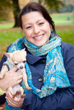 Happy woman with dog Stock Photography