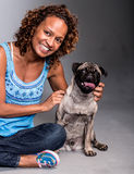 Happy woman with a dog Stock Photo
