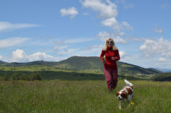 Happy Woman and Dog in a Countryside royalty free stock photos