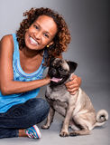 Happy woman with a dog Royalty Free Stock Photos
