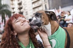Happy woman and dog with green handkerchief, symbol of legal abortion campaign