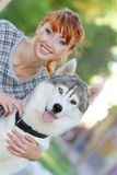 Happy woman with dog haski outdoors Stock Images