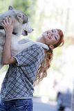 Happy woman with dog haski outdoors Royalty Free Stock Photography