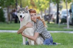 Happy woman with dog haski outdoors Royalty Free Stock Image