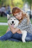 Happy woman with dog haski outdoors Stock Photography
