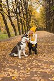 Happy woman with dog hugging outdoor.  Stock Photos