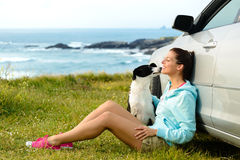 Happy woman and dog on travel stock photography