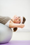 Happy woman doing abdominal crunch on fitness ball Stock Photography
